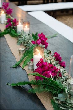 I never thought of using bougainvillea as a centerpiece or table runner, but the colors of the flower are so rich and this looks so fabulous and organic :)