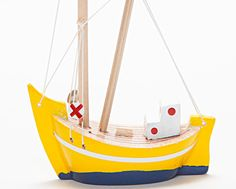 Handmade/Hand Painted Wooden Fishing Boat by Oyma on Etsy. $15. >> This shop is wonderful! Might need a little boat for my shelf!
