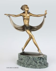 A beautiful large Art Deco Austrian bronze figure by Josef Lorenzl,circa 1930, depicting a stylish attired young woman, with gold cold-painted finish, mounted on a substantial green marble base- 41cm high