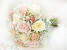 Bouquet of mixed roses and babybreath
