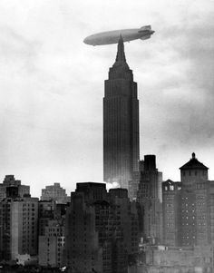 NYC. Hindenburg zeppelin over the Empire State Building, 1936