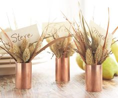 Ornamental Grasses Place Cards  Simple copper pipe fittings become showstopping table decorations when filled with ornamental grasses. Tuck the name cards in among the grasses to create rustic yet elegant place cards.  Editor's Tip: These arrangements were made with seed heads of reed canary grass, switch grass, and feather reed grass. Visit a florist, greenhouse, or farmer's market to find different grass varieties.