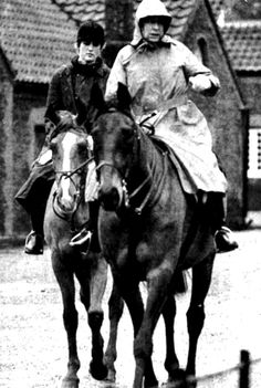 Diana riding with the Queen.