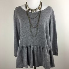 """[Free People] Gray Knit Peplum Tee Medium Cool and casual peplum tee by We The Free from Free People. 3/4 sleeves. Looser fit. Looks great with a statement necklace. The perfect pairing for your patterned pants. Effortless.  Color: Gray Size: Medium Bust: 19"""" Length: 23"""" Condition: EUC. No flaws.  No Trades! No PayPal! Free People Tops Blouses"""