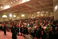 Hundreds of women in praise and worship