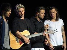 One Direction performing in Glasgow on their On the Road Again Tour, October 2015. From left to right: Louis Tomlinson, Niall Horan, Liam Payne and Harry Styles