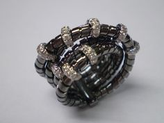 18kt gold ring with black rhodium and diamonds