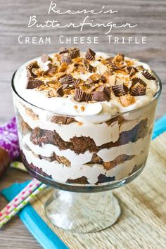 Reese's Butterfinger Cream Cheese Trifle {Tastes of Lizzy T} Peanut butter and chocolate lovers will go crazy over this Reese's Butterfinger Cream Cheese Trifle. It has an Oreo cake layered with fluffy cream cheese filling and chopped up Butterfinger and Reese's cups!