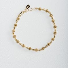 Filigree Ball Chain Bracelet.Intricate detailed chain bracelet of gold filled 5mm filigree beads hand wired to give the extra delicate touch. #Vilingdesigns #daintyjewelry #bracelets #womensfashion #style #jewelry #gold