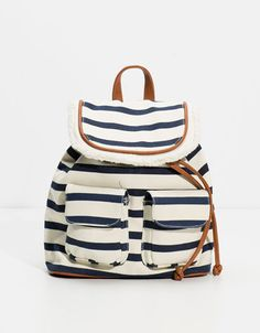 Bags and stripes are a must of the season !
