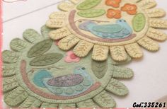 """Beautiful felt penny rugs. I really like the """"finger"""" shaped edging instead of…"""