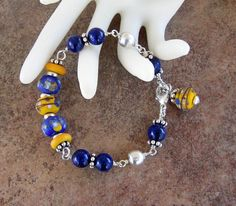 Colorful Rustic Blue and Yellow Lampwork and by MarthaDzJewelry