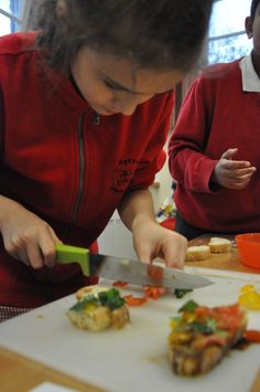 Learning new skills to chop fresh tomatoes for bruschetta at Hythe Primary School-well done!