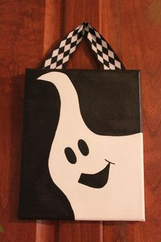 Halloween ghost hand painted canvas. $15.00, via Etsy.