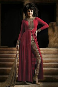 """http://www.istyle99.com/Semi-Stitched-Anarkali-Style-Suits/Red-Semi-Stitched-Georgette-Party-Wear-Salwar-Suit-5446.html Red Semi-Stitched Georgette Party Wear Salwar Suit - Rs 973 Stitch Type: Semi Stitched Occassion Type: Party Wear Kameez Colour: Red Bottom Colour: Beige Dupatta Colour: Beige Kameez Fabric: Georgette Bottom Fabric: Unique Brocade Dupatta Fabric: Chiffon Inner:Santoon Work Style: Embroidery Work CUSTOMIZED UP TO: 44"""" Style Type: Straight Cut Neck Style: Round"""