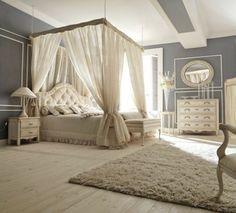 chambre à coucher de déco romantique avec lit à baldaquin