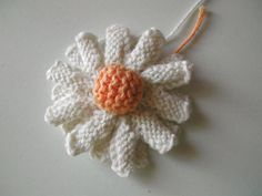 A couple free knitted flower patterns.