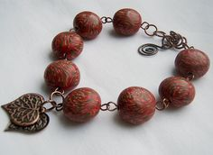Copper Charm | These polymer clay beads were made from a dis… | Flickr
