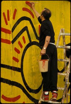 Keith Haring painting a mural on the Berlin Wall nearby Checkpoint Charlie on October On August 1961 construction started on the Berlin Wall, tearing apart the German capital. Famous Artists, Great Artists, Jm Basquiat, Keith Haring Art, Tv Movie, Pittsburgh, Principles Of Art, Berlin Wall, Arte Pop