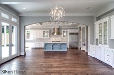 traditional living room, with detailed ceiling and transition into kitchen  (photo by Vladimir Ambia Photography)