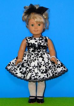Adorable Black and White Holiday Dress fits American Girl Doll or other 18 inch doll. $11.99, via Etsy.