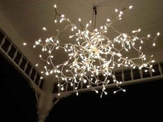Have a broken umbrella? Spray paint the frame white and twist twinkling lights around the arms for an instant holiday lighting fixture. - Via Buzzfeed