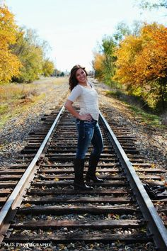 Railroad pictures. Fall photos. Fall pictures. Senior pictures on railroad tracks. Poses.