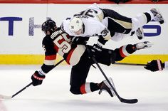 Pittsburgh Penguins Jussi Jonkinen (36) collides with Ottawa Senators Sergei Gonchar (55) during the first period of their NHL hockey game in Ottawa, Ontario, Monday, April 22, 2013. (AP Photo/The Canadian Press, Justin Tang)