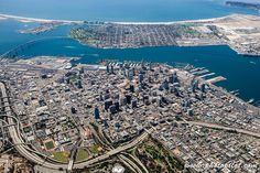 High bird's eye view of Downtown San Diego, showing the beach and Coronado Bridge in the background.