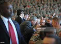 US President George W. Bush greets troops after making remarks on November 25, 2008 at Fort Campbell in Kentucky. Bush thanked military personnel who have recently returned from Iraq or Afghanistan. Fort Campbell is the home of the 101st Airborne Division. AFP PHOTO/Mandel NGAN
