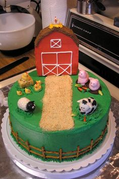 This one would be easy and would work well for ice cream cake. Could use Levi's new Schleich animals on top.