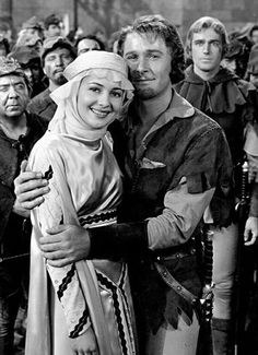 Olivia de Havilland and Errol Flynn in The Adventures of Robin Hood. I can watch this movie over and over. One of my favorites.