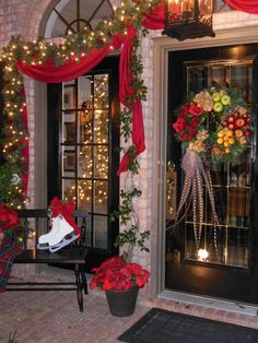 Make the outside of your home as ready for the holiday season as the inside with these outdoor Christmas decorating ideas. Our holiday decorating ideas, including beautiful Christmas greenery, festive light displays, and more, are sure to get your yard Ch Porch Christmas Lights, Christmas Front Doors, Christmas Greenery, Decorating With Christmas Lights, Noel Christmas, Outdoor Christmas Decorations, Holiday Lights, Xmas, Holiday Decor