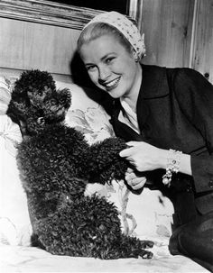 Grace Kelly and her poodle, Oliver, a wedding present from Cary Grant