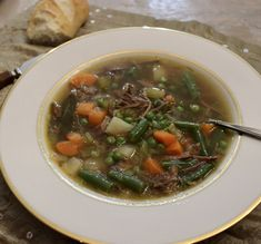 Easy homemade Beef Vegetable Soup Recipe by Old Cut Kitchen using local ingredients from Norfolk County, Ontario's Garden Vegetable Soup Ingredients, Vegan Vegetable Soup, Basic Soup Recipe, Beef Soup Recipes, Homemade Soup, Homemade Recipe, Beef Bones, Frozen Peas, Bean Soup