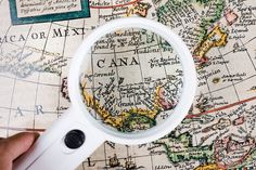 A person holding magnifying glass over map #paid, , #AFFILIATE, #Affiliate, #holding, #map, #glass, #person Ocean Backgrounds, Photography Backdrop Stand, North And South America, Star Sky, Magnifying Glass, Free Photos, Stock Photos, Goal, Canada