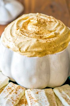 Pumpkin Cheesecake Dip! This easy pumpkin dip is the best way to cure a crowd's cravings for fall comfort food. Plus, there's white chocolate covered graham crackers for dipping! #pumpkinrecipes #pumpkineverything | HomemadeHooplah.com