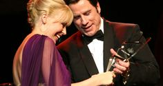 Kylie Minogue accepts award from John Travolta at 2008 LA Black Tie Gala