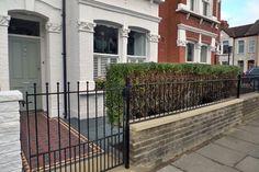 hedge, wall and railings, mosaic path