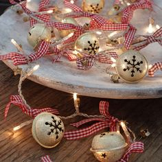 """Jingle Bells"" Light Chain--string of white LED lights with sleigh bells and red gingham ribbons.  Great accent for a buffet/sideboard centerpiece."