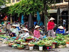 Women on the street corner selling fresh vegetables