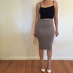 Taupe Midi Pencil Skirt Beautiful Taupe Bodycon Midi skirt. Brand new. Never worn. No flaws. 87% polyester, 13% spandex. Available in S-M-L. Bundle for 10% off. No Paypal. No trades. No offers will be considered unless you use the make me an offer feature.     Please follow  Instagram: BossyJoc3y  Blog: www.bossyjocey.com Skirts Midi