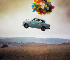 car flying with balloons