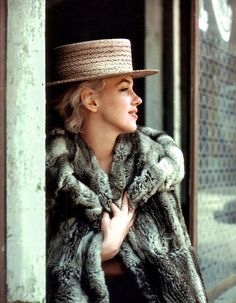 Marilyn Monroe- not exactly a gentleman, but she wears a straw hat better than any dapper gent
