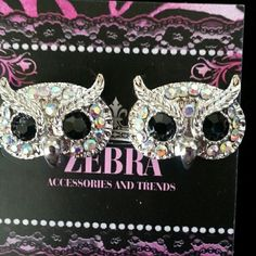 Cute Sparkly Owl Earrings Price Firm Silvertone. Iridescent Rhinestones. Black Rhinestones for eyes.  Studs. Owls measure 1/2 inch x 1 inch. Boutique  Jewelry Earrings