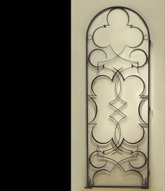"Edgar Brandt Arabesque wrought iron door/gate  c.1927-28 Deeply patinated wrought iron with gilt detailing H: 85 ¼"" x W: 29 ¼"" x D: 2 ¼"""