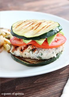 Herbed Turkey Burgers with Zucchini Buns~Tip can also use eggplant for buns~     8 – 10 oz ground organic, lean turkey meat     2 tablespoons fresh oregano, chopped     2 garlic cloves, minced     4 thick slices of zucchini (or eggplant, summer squash, etc.)     Olive oil spray     Salt & pepper to taste     Toppings: sliced tomato, avocado, ketchup, mustard, hot sauce, etc.