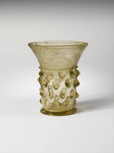 Beaker Date: 13th century Culture: South German Medium: Glass Dimensions: Overall: 3 13/16 x 3 1/4 in. (9.7 x 8.3 cm) at foot: 2 in. (5.1 cm)