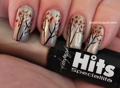 tree branches with dried leaves in red, black and orange over silver nail polish
