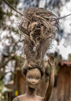 Relic: After Barrera's death in 2011, the area became a popular tourist attraction where visitors bring more dolls - which now number in the thousands